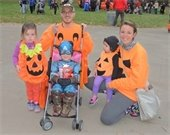 Family dressed up as pumpkins at Wicked Woods at Green Lakes