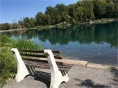 Bench in front of lake
