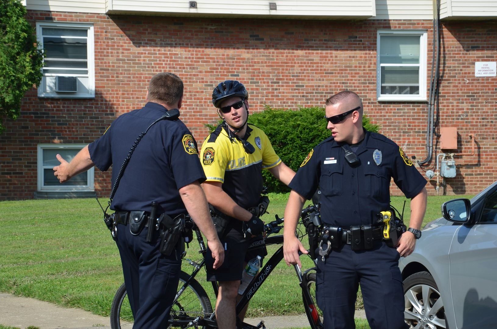 Officers stop to talk with a bike officer