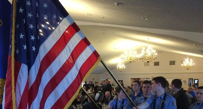 Officers hold flags during an event